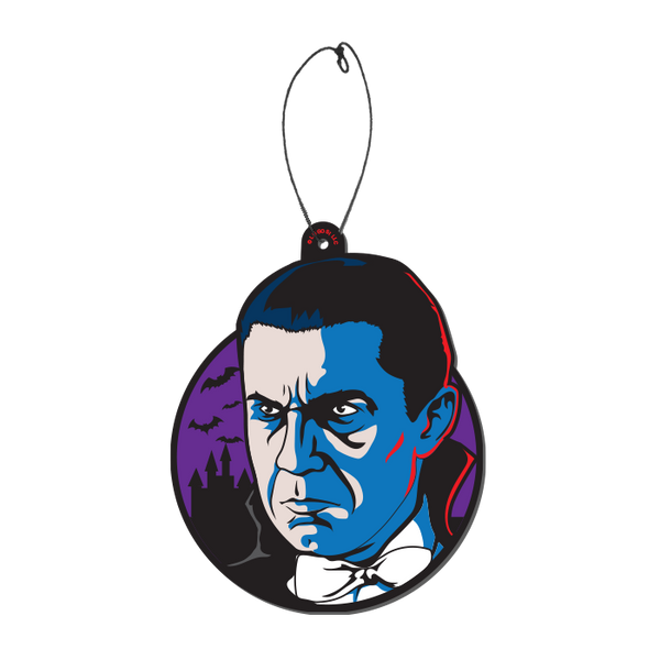 This is a Universal Monsters Bela Lugosi Dracula air freshener by Trick Or Treat and he has black hair, cape, bow tie and is in front of a purple circle with bats and a castle, with a plastic hanger.