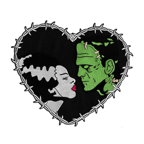 This is a Universal Monsters Bride of Frankenstein Heart back patch and has a woman with a white face, black hair that has a white streak and red lips and a greek man with black hair and stitches in his face.