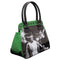 This is a Universal Monsters Bride of Frankenstein handbag purse and it is black and green glitter with studs and two handles and the bride has on a white dress and black and white hair.