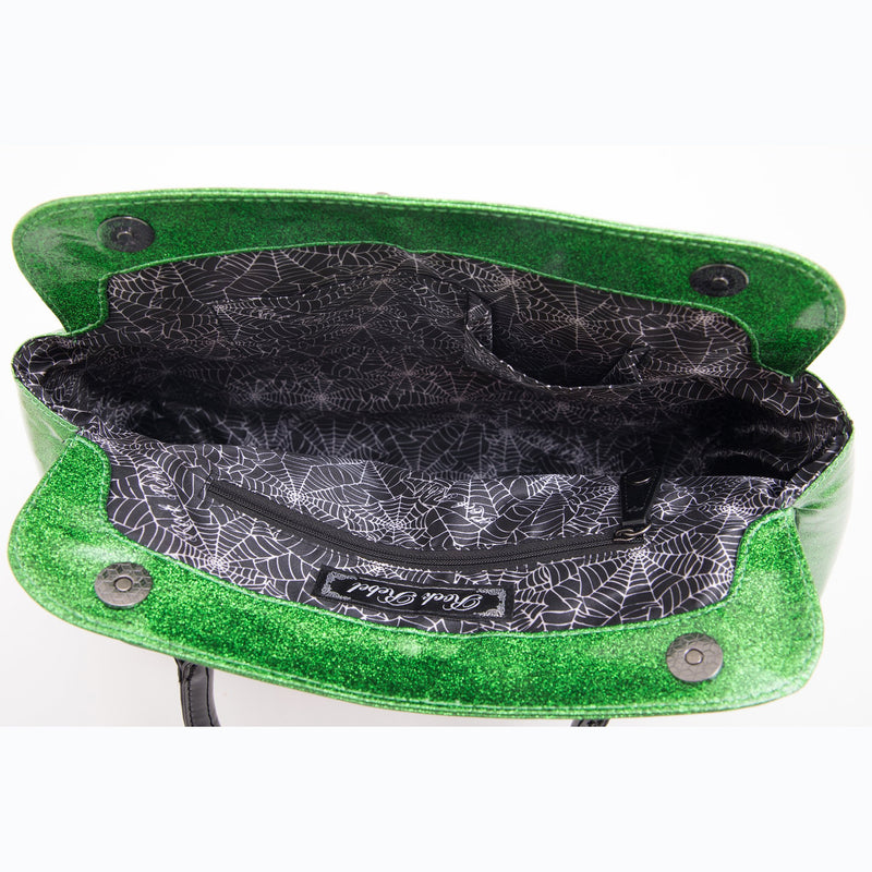 This is a Universal Monsters  handbag vegan purse and it is black and green glitter with two handles and cobweb lining.