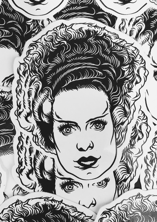This is a Universal Monsters Bride of Frankenstein face sticker and she has black and white hair.