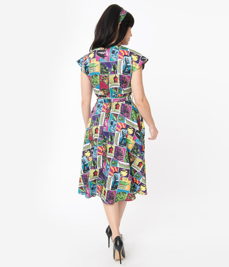 This is a Universal Monsters Hedda dress from Unique Vintage and it has Creature From the Black Lagoon, Frankenstein, Dracula, Mummy, Bride and Wolfman and it has a belt and the model is wearing black shoes.