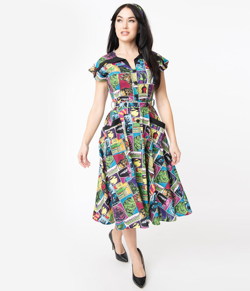 This is a Universal Monsters Hedda dress from Unique Vintage and it has Creature From the Black Lagoon, Frankenstein, Dracula, Mummy, Bride and Wolfman and has a black collar and two pockets and the model is wearing black shoes.