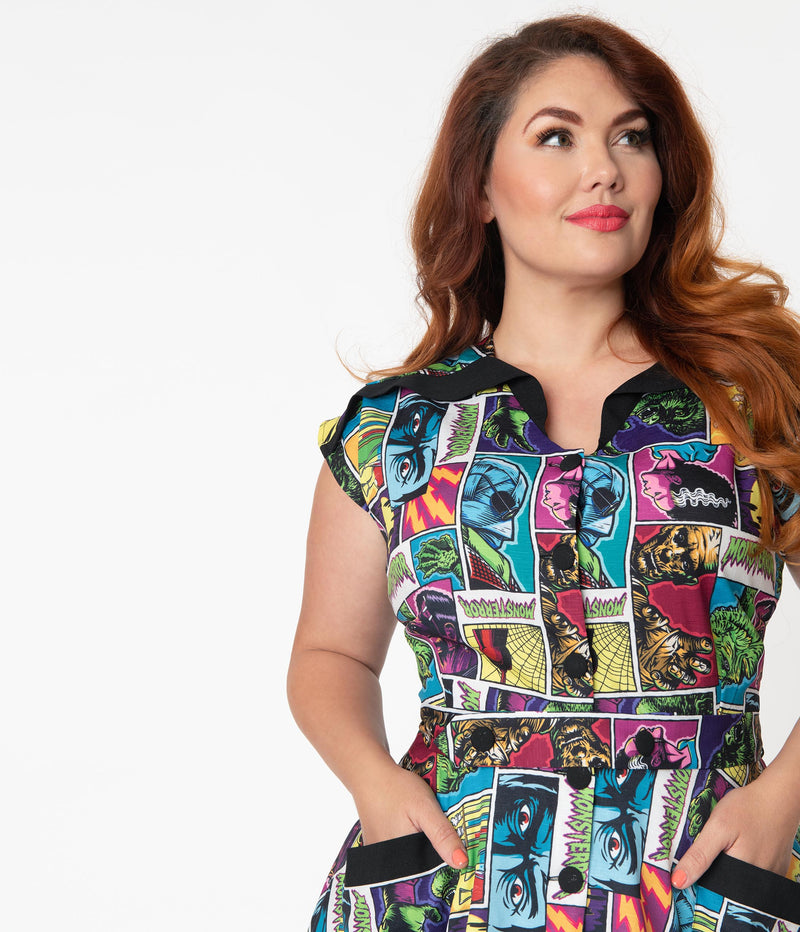 This is a Universal Monsters Hedda dress from Unique Vintage and it has Creature From the Black Lagoon, Frankenstein, Dracula, Mummy, Bride and Wolfman and has a black collar and two black pockets on a plus size model with red hair.