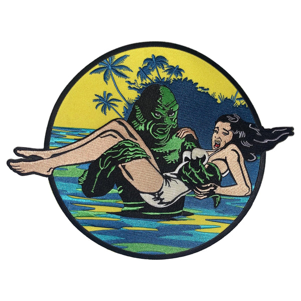 This is a Universal Monsters Creature From the Black Lagoon patch and has a woman with dark hair and a white bathing suit being carried out of the water by a green creature.