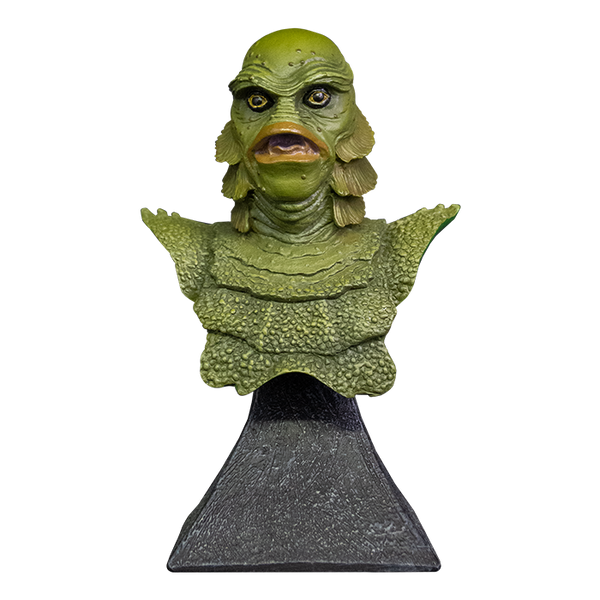 This is a Universal Monsters Creature From the Black Lagoon mini bust that is a green monster with big lips and he is on a grey stand.