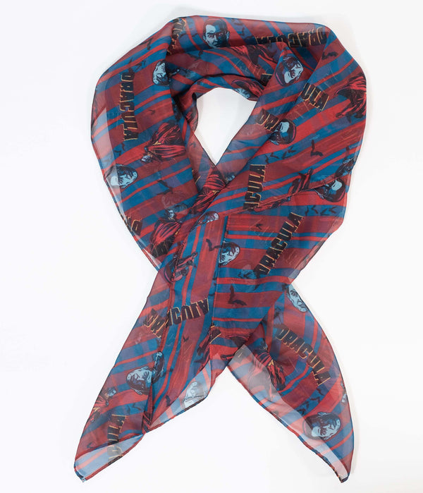 This is a Universal Monsters Dracula chiffon hair scarf by Unique Vintage and it is red and blue with his head.