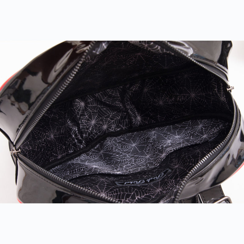 This is a Universal Monsters Heart backpack purse and it is black with red piping and has cobweb lining inside.