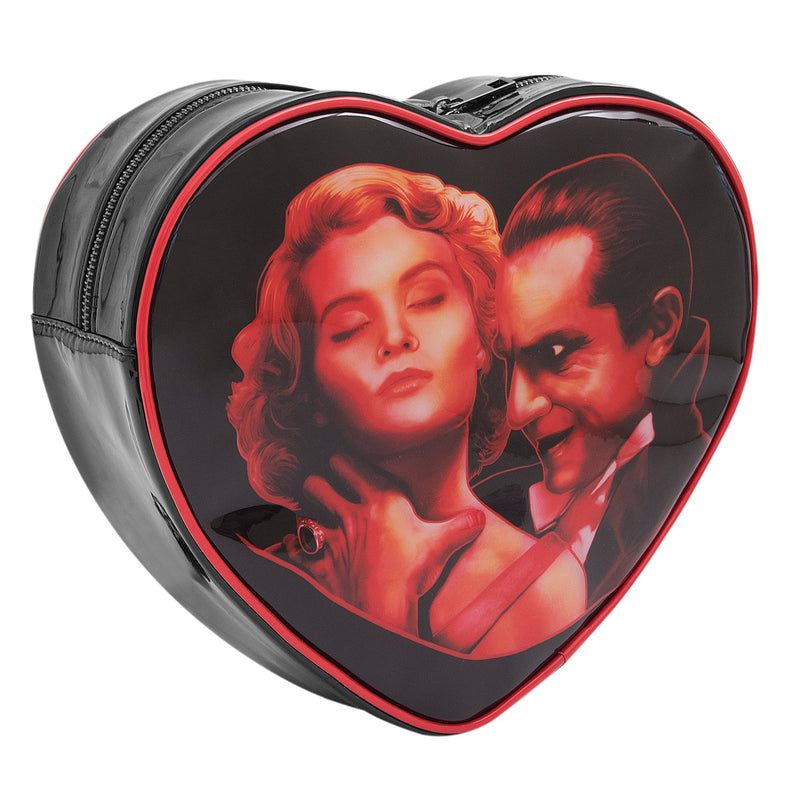 This is a Universal Monsters Heart backpack purse and ihe is choking a woman with blonde hair.