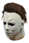 This is a Halloween 1978 Michael Myers mask and he has a white face, tan neck and brown hair.