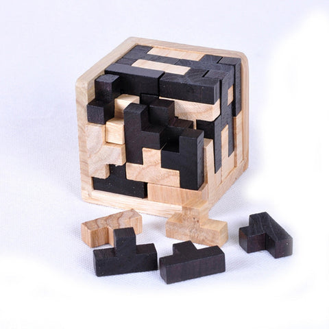 Wooden Puzzle cube with few loose pieces in front