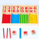 red blue green and yellow math sticks inside the box with example of calculations made