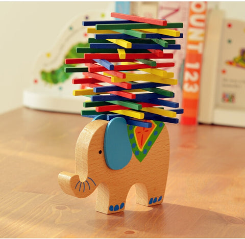 Elephant toy with many colorful sticks balancing on it