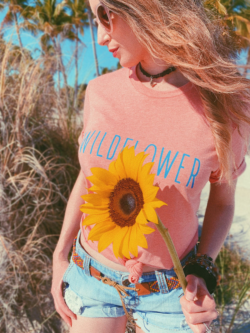 This women's Wildflower tee is perfect for your inner wild child. This Wildflower t shirt is very soft and comfy and perfect to travel in! In a world full of flowers, be wild!