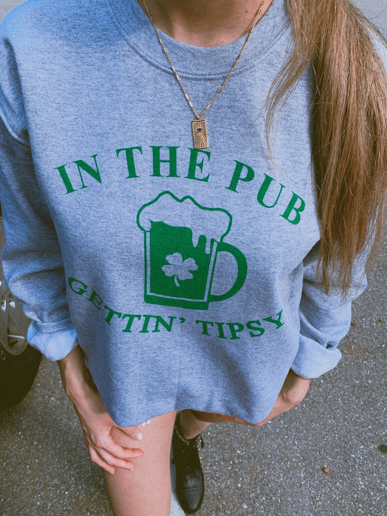 Are you ready to celebrate St. Patty's Day with style and humor? This cute In The Pub Gettin' Tipsy sweatshirt is a great shirt to show that not only are you there to have a good time but you're also ready to get shamrocked!  Edit alt text