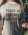 Wear this tee and let people know that they need to teach you about Football and give you a beer while they are at it. This funny football shirt is perfect to wear on game day to let everyone know that you will be lost and perhaps not understand what's going on but to give you a beer anyways!!