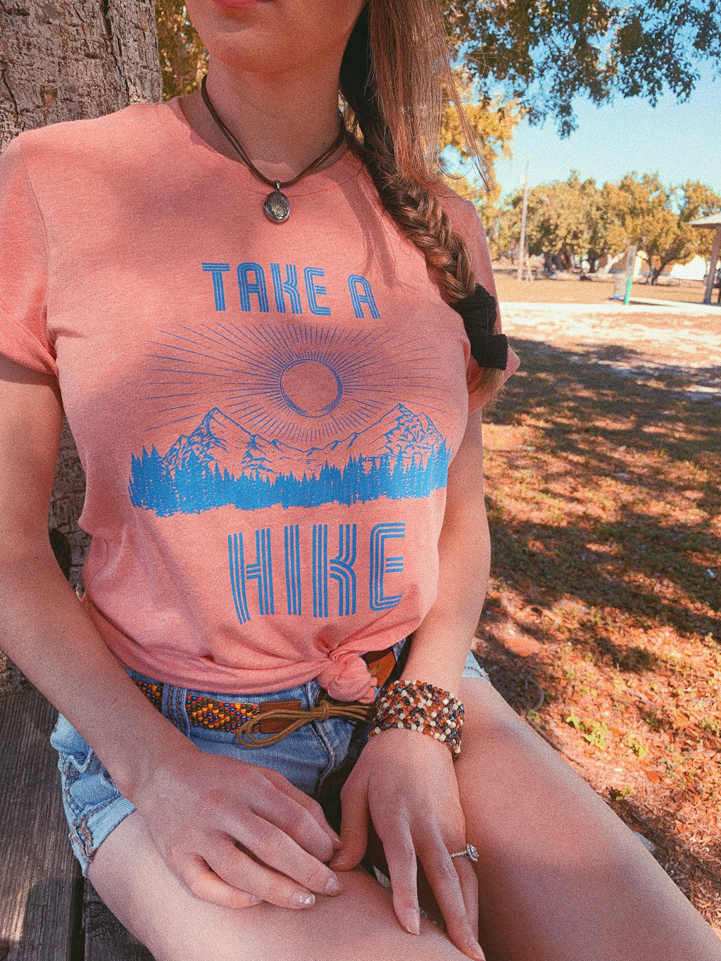 Take a Hike with your best friend in our women's Take a Hike tee! The perfect adventure shirt to explore the world and add to your vacation wardrobe!