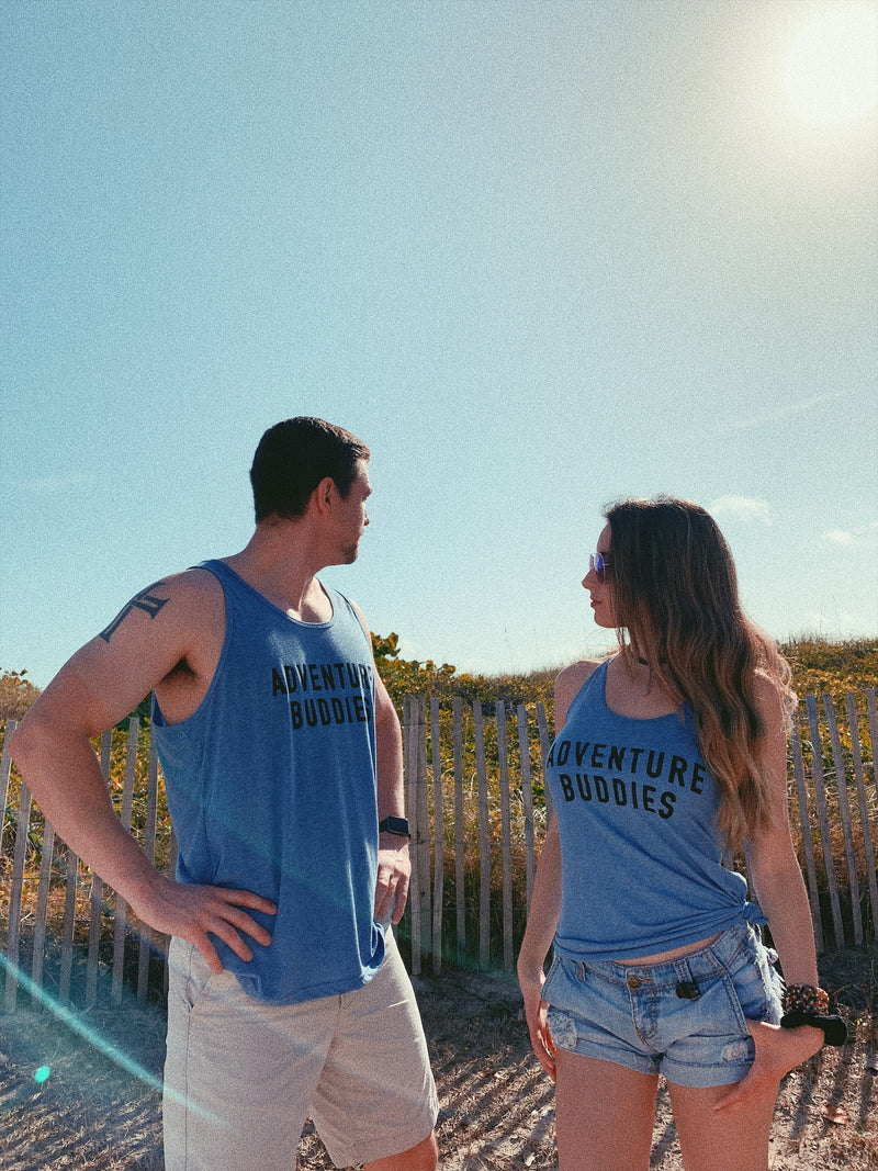 What better way to adventure the world than with your loved one in these cute matching adventure buddies tank tops! These super soft and cute tank tops are perfect to take on your next vacation whether it's on your honeymoon or a weekend getaway with your best friends!
