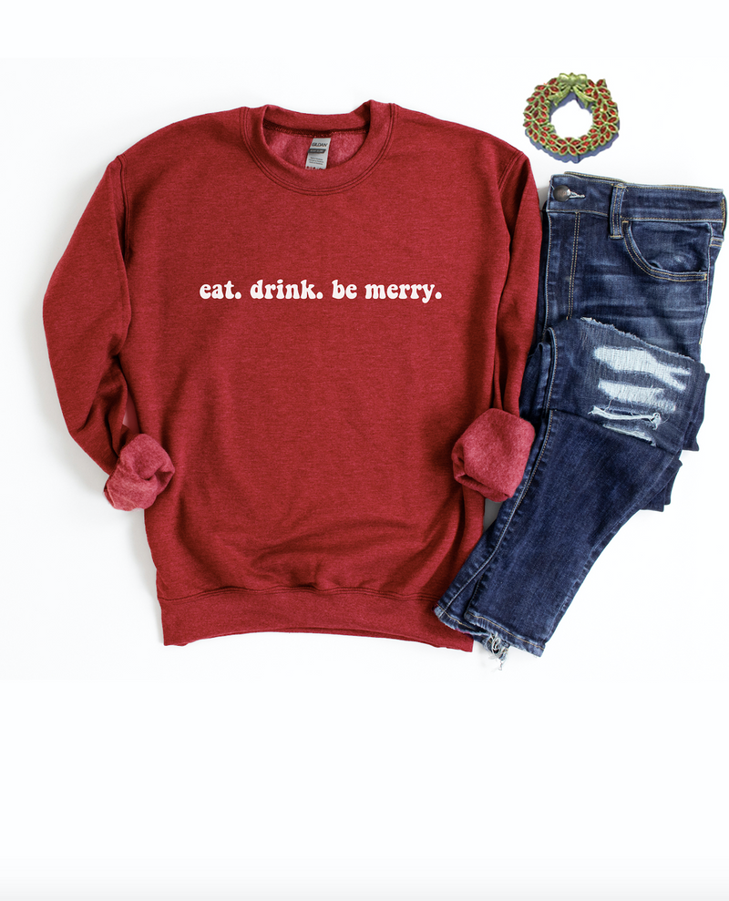 Eat, Drink and Be Merry this holiday season in our cozy Christmas Sweatshirt!