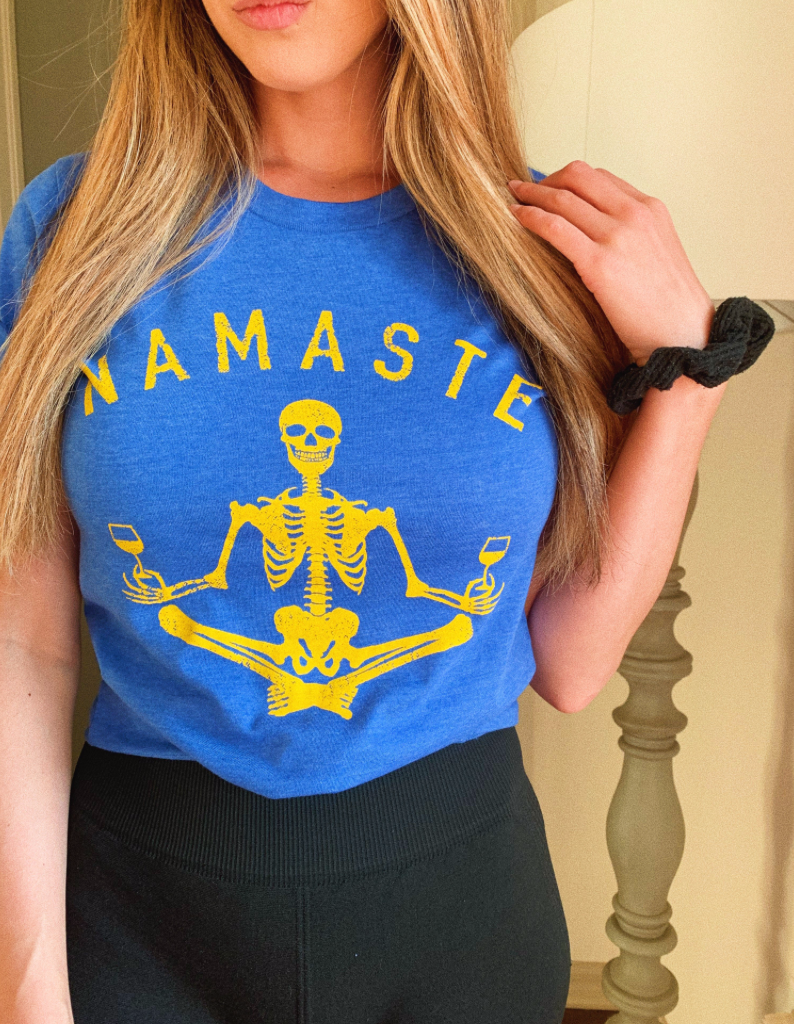 NAMASTE! This cute wine shirt is for everyone out there who has to quarantine Netflix and chill.  Relax and enjoy lots + lots of wine!
