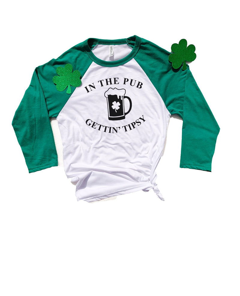 Are you ready to celebrate St. Patty's Day with style and humor? This cute In The Pub Gettin' Tipsy Tee is a great shirt to show that not only are you there to have a good time but you're also ready to get shamrocked!