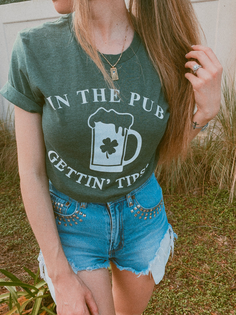Are you ready to celebrate St. Patty's Day with style and humor? This cute In The Pub Gettin' Tipsy tank is a great shirt to show that not only are you there to have a good time but you're also ready to get shamrocked!