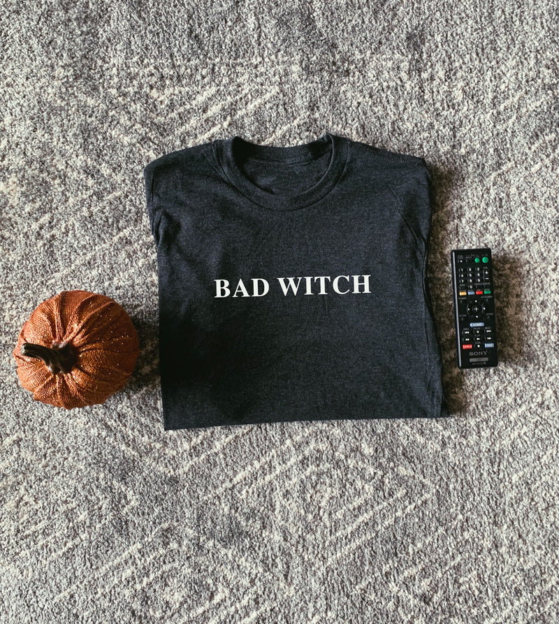 Show the world what a bad witch you are in this super cute and comfy tee!  Perfect Halloween shirt to wear this spooky season!