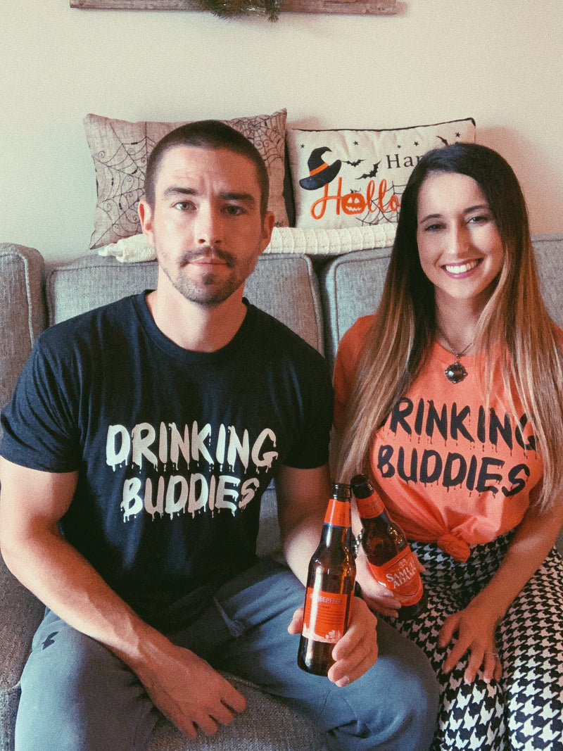 What better way to celebrate Spooky Season than matching with your loved one in these Drinking Buddies tees! These matching shirts are perfect to go to a Halloween Party or just stay home watching scary movies all night.