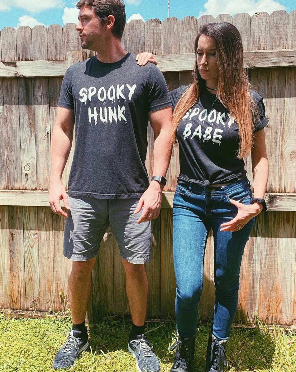 What better way to celebrate Spooky Season than matching with your loved one in these Spooky Babe and Spooky Hunk tees! These matching couples shirts are perfect to go to a Halloween Party or just stay home watching scary movies all night.