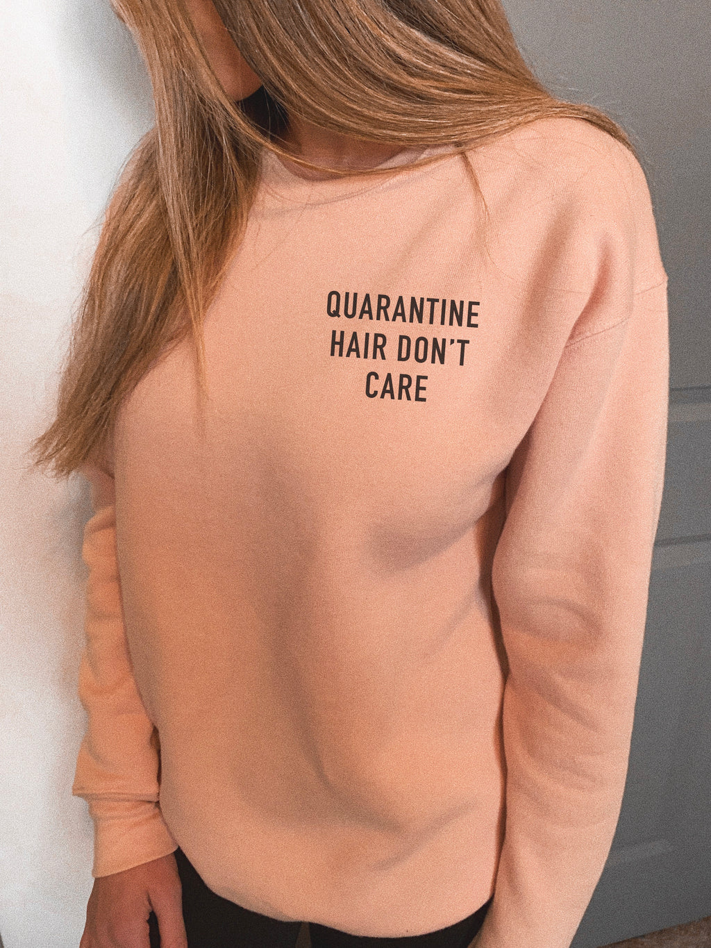 This sweatshirt is great to wear if you plan on lounging around at home. Whether you will be watching Netflix and chilling or just relaxing at home, this funny sweatshirt comes in handy as a reminder that you're rocking your quarantine hair and you just don't care!
