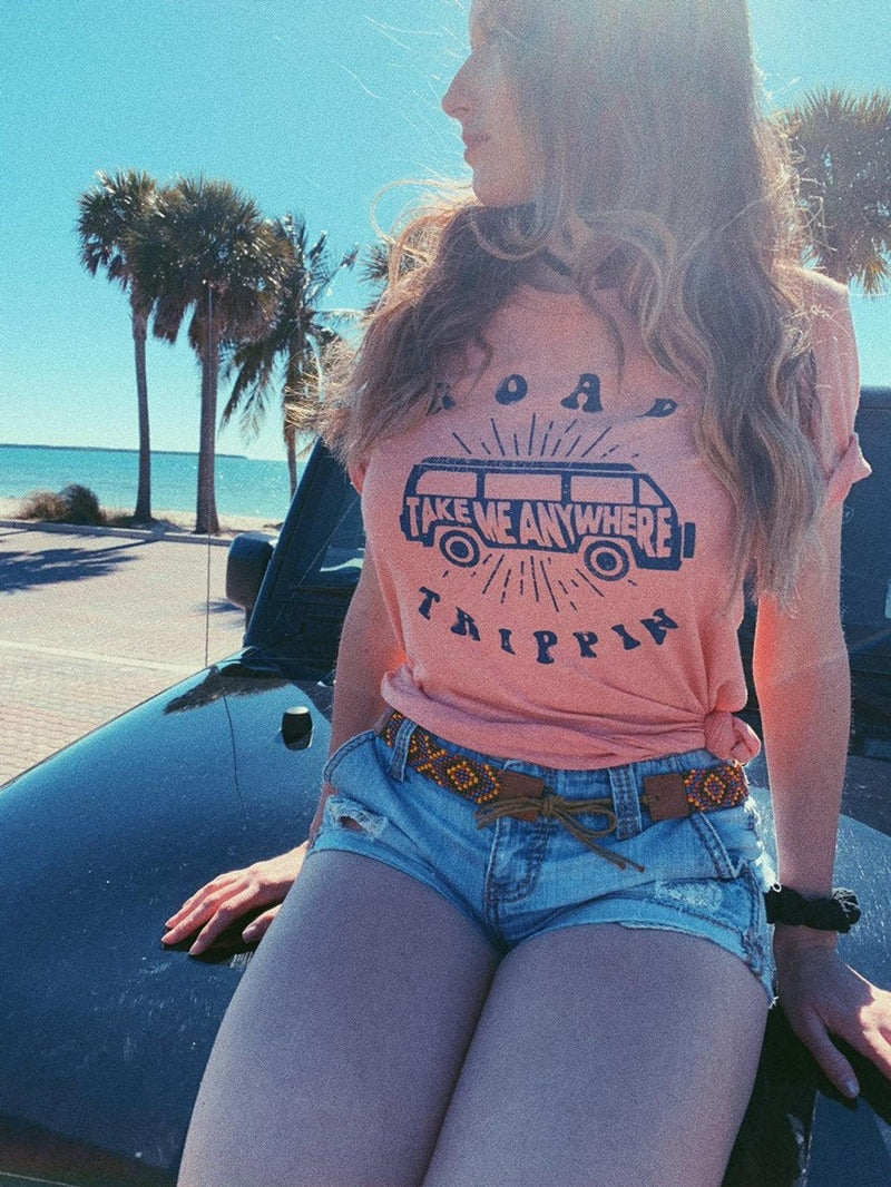Travel the world in our cute road trip tee! This cute women's travel shirt is perfect to wear on your next vacation! Enjoy that road trip whether it's across the country or within the state, this tee is perfect to be comfy and cozy!  Edit alt text