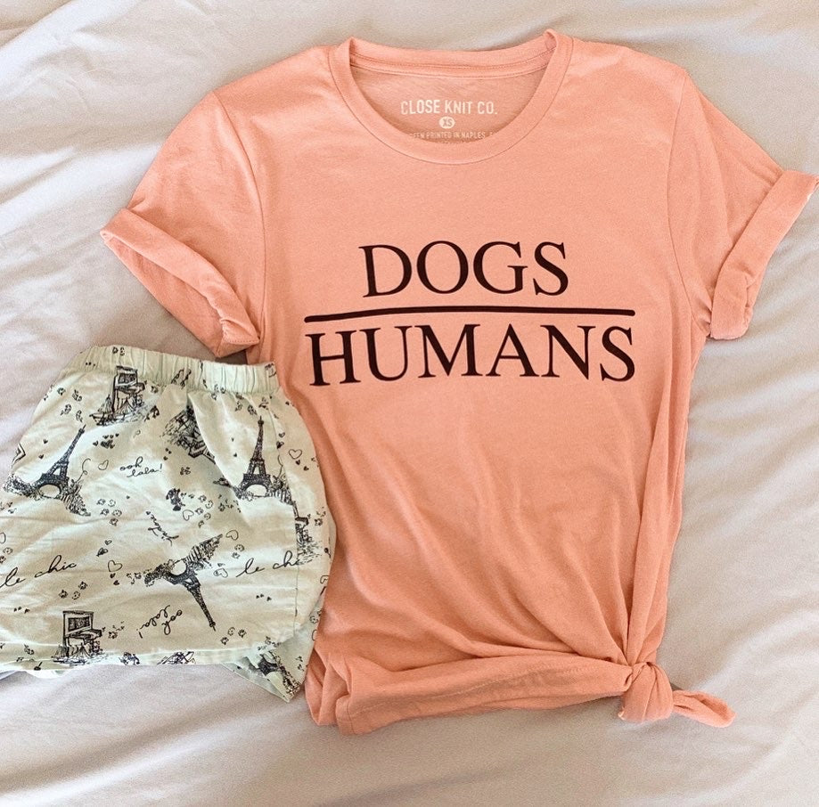 This cute dogs over humans tee is the perfect dog mom shirt to let people know what a beautiful world it would be if people had hearts like dogs.