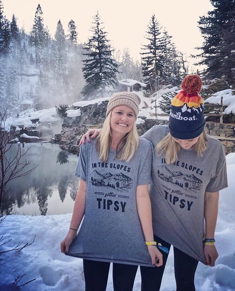 Skiing and drinking..the perfect combination! Rock this super soft and cozy skiing shirt while you're in the slopes this winter. Perfect for any ski lover and even great for ski bachelorette party shirts or a girl's trip.