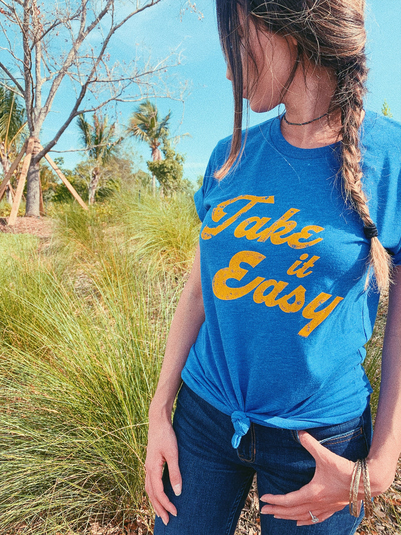 Take it easy shirt. Take it easy and take it as it comes. This cute motivational shirt for women is great to spread some positivity. Take a deep breath, relax and TAKE IT EASY.