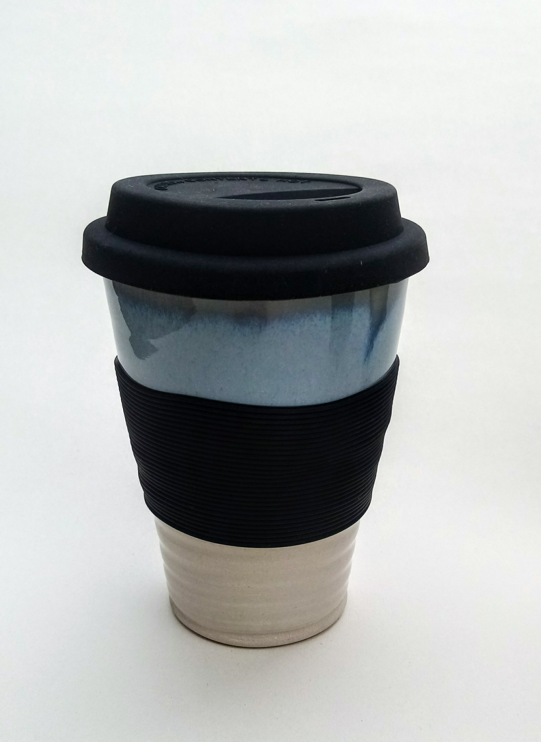 Hand thrown stoneware keep cup. Blue and white.