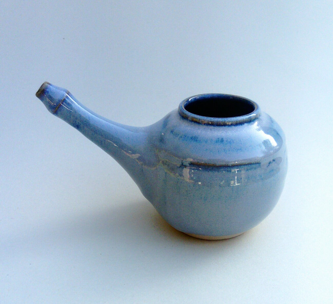 Neti pot, nasal irrigation. Blue aurora.