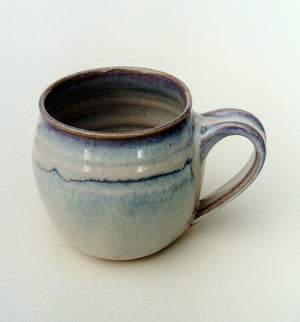 Hand thrown round mug, sold individually . Sunset strand.