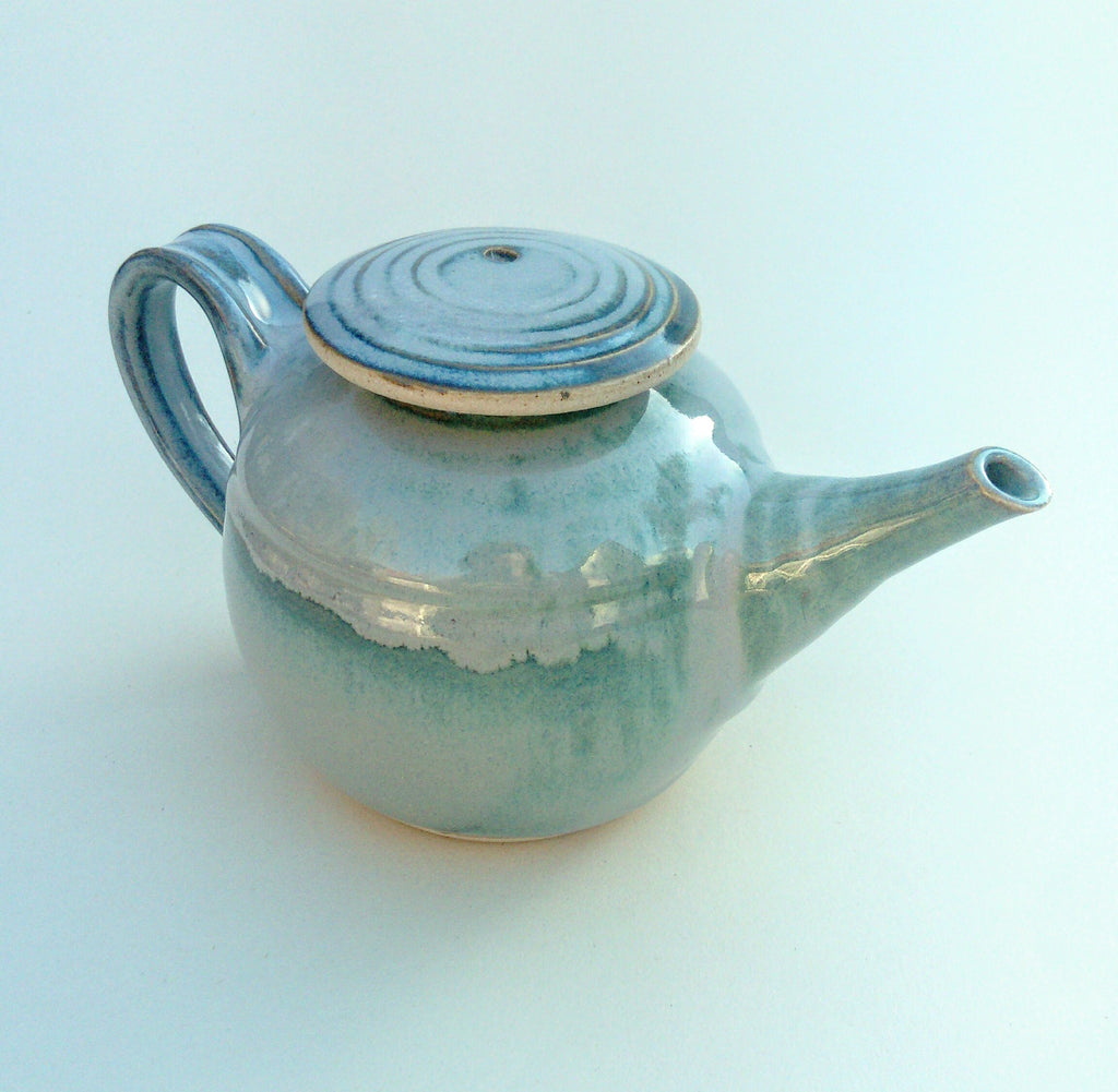 Hand thrown tea pot. Blue aurora.