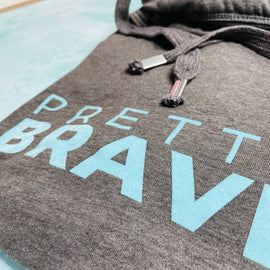 PRETTY BRAVE HOODIE ADULTS + KIDS in CHARCOAL/MINT