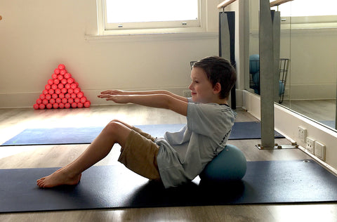 V-Sit with Pilates Ball Supporting the Back
