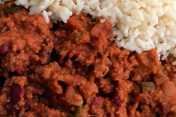 Chilli con carne done, served with rice.