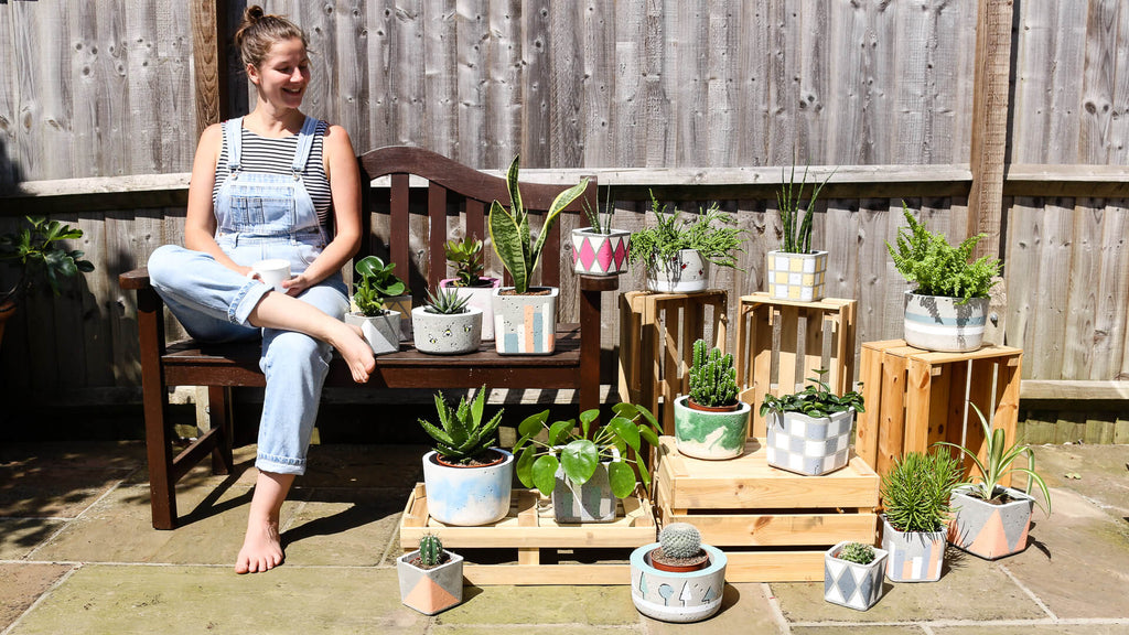 A variety of stylish handmade concrete plant pots made by sarah cheetham, founder of Twig plants and pots