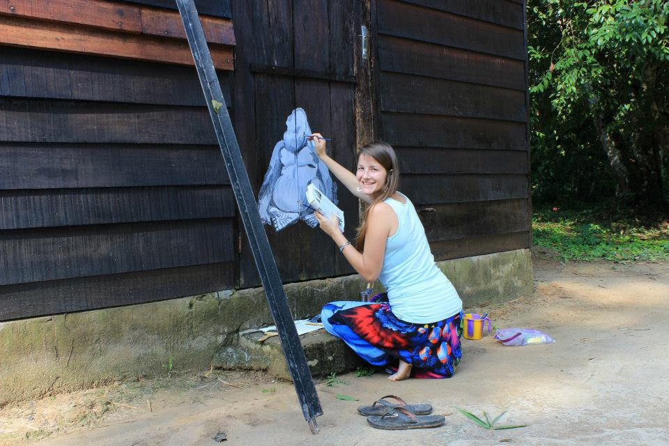 Sarah Cheetham, Twig founder, paiting a blue gorilla in the Congo