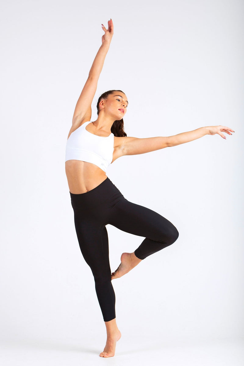 Aeon Vie Define Contour seamless front leggings in Black with white Stellar sports bra performing dance pose
