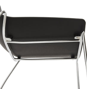 Tikada Chair comes in black and white with a modern style and is available from roomshaped.co.uk