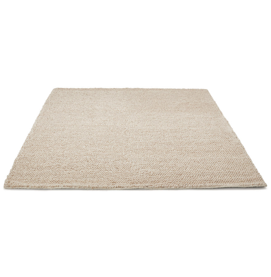 Nod Rug comes in brown and grey with a modern style and is available from roomshaped.co.uk