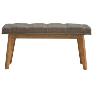 Lucy Buttoned Bench comes in an oak finish with a country style and is available from roomshaped.co.uk