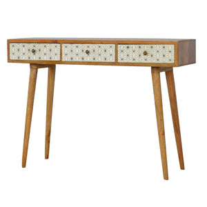 Repton Console comes in white with a geometric style and is available from roomshaped.co.uk