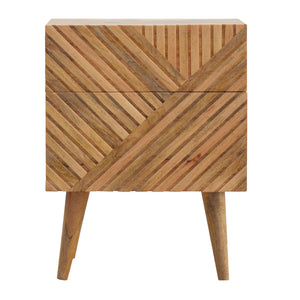 Astrid Bedside Drawers comes in an oak finish with a carved style and is available from roomshaped.co.uk