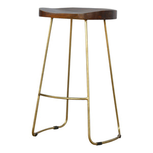 Pinjo Stool comes in chestnut and a gold finish and a natural finish with a gold frame style and is available from roomshaped.co.uk